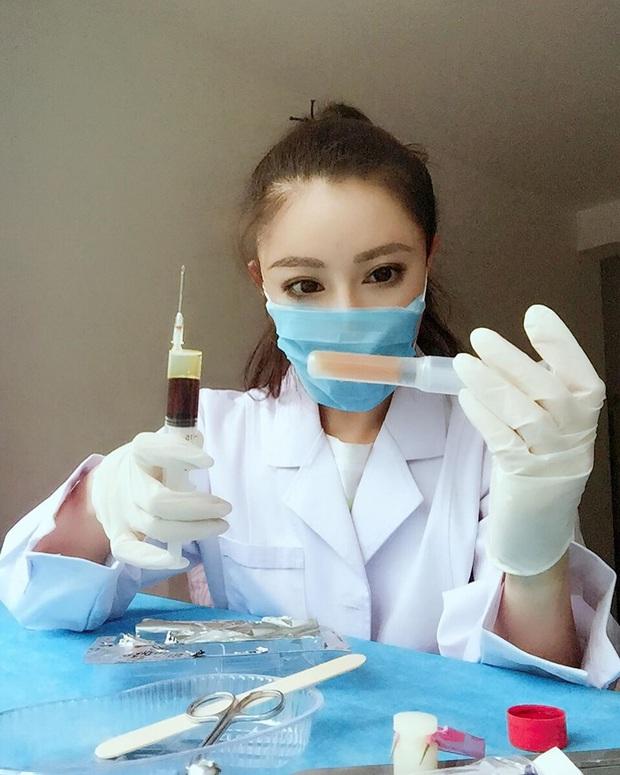 Nữ bác sĩ mặt thiên thần, body cơ bắp của Trung Quốc thông báo tin cực vui về virus corona, đã trở lại tập luyện sau thời gian tối mặt vì đại dịch - Ảnh 1.