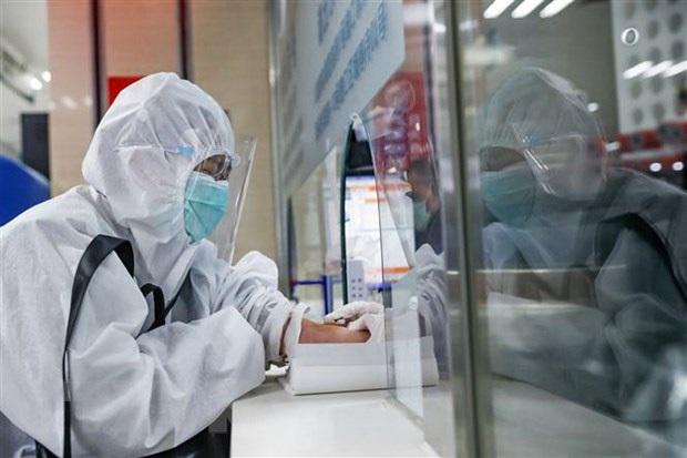 Trung Quốc: 13 ca nhiễm SARS-CoV-2 mới, chủ yếu là người nhập cảnh - Ảnh 1.
