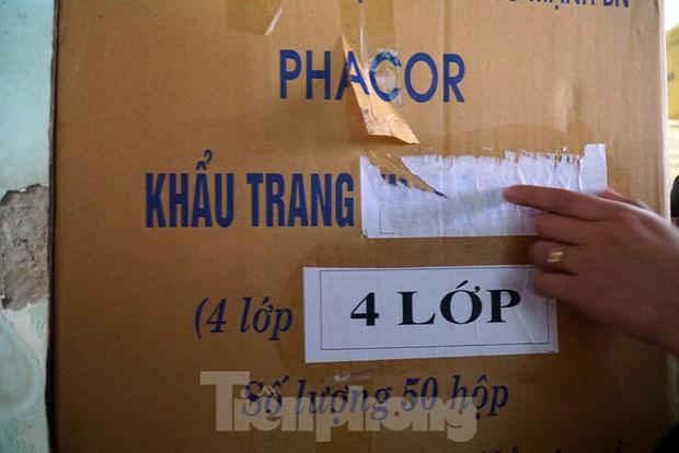 Tạm giữ 500.000 chiếc khẩu trang y tế không rõ nguồn gốc ở Hà Nội - Ảnh 5.