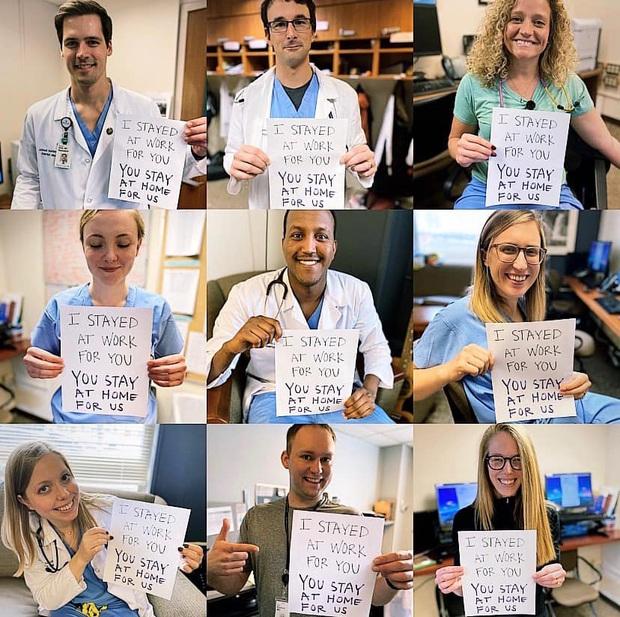 Các y bác sĩ trên toàn thế giới đồng loạt giơ cao thông điệp ý nghĩa: Chúng tôi đang làm việc vì các bạn còn các bạn hãy ở nhà vì chúng tôi - Ảnh 8.