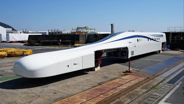 Nhật Bản giới thiệu tàu điện siêu tốc mới: Sử dụng công nghệ sạc không dây, đạt vận tốc tối đa lên tới hơn 500km/h - Ảnh 1.