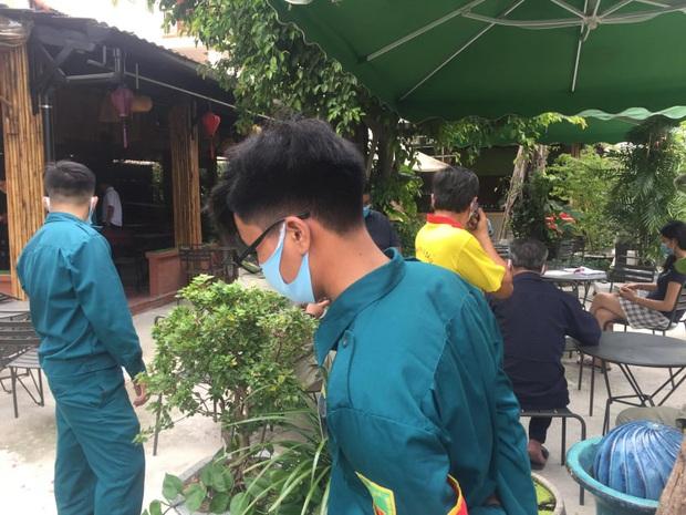 Thanh niên mặc đồ Grab nổ súng tại quán cà phê ở Bình Dương khiến 1 người bị thương - Ảnh 1.