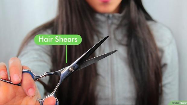Ở nhà tránh dịch, tôi đã học được cách tự tỉa tóc không hề xô lệch mà cực đơn giản - Ảnh 1.