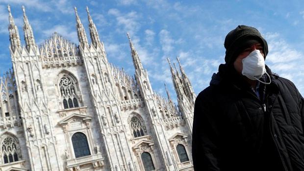 Italy có gần 11.000 người chết, dự báo dịch đến đỉnh 10 ngày tới - Ảnh 1.