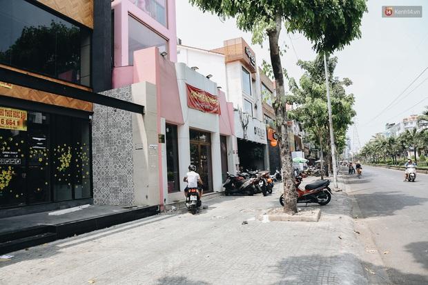 Giá thuê hàng nghìn USD/tháng nhưng nhiều cửa hàng trên đường Phan Xích Long phải ngưng hoạt động vì dịch Covid-19 - Ảnh 1.