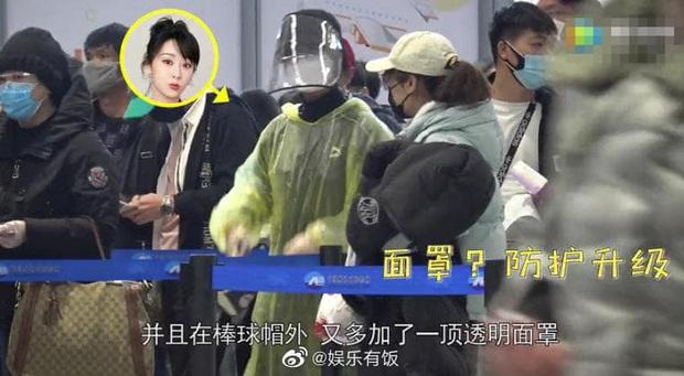 Dương Tử gây bão với thời trang sân bay áo mưa, khẩu trang phòng chống dịch bệnh COVID-19 kín mít từ đầu tới chân - Ảnh 6.