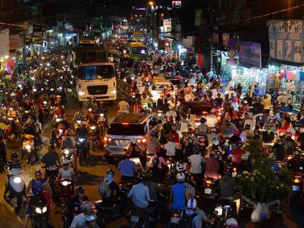 Vì sao Bộ GTVT đề xuất bắt buộc xe máy bật đèn vào ban ngày? - Ảnh 2.