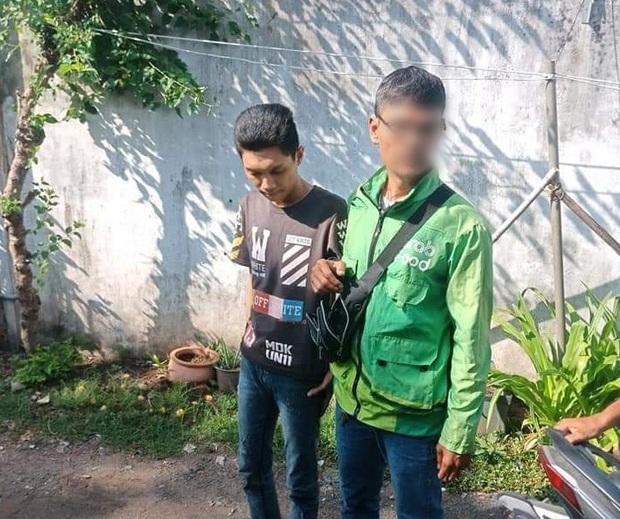 Bắt tài xế GrabBike có hành vi cướp giật điện thoại của người mẹ đang bồng con nhỏ ở Sài Gòn - Ảnh 2.