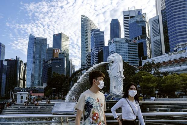 Đứng trước cơn sóng thần bệnh nhân Covid-19, Singapore đã ứng phó ra sao để duy trì tỷ lệ tử vong thấp? - Ảnh 1.