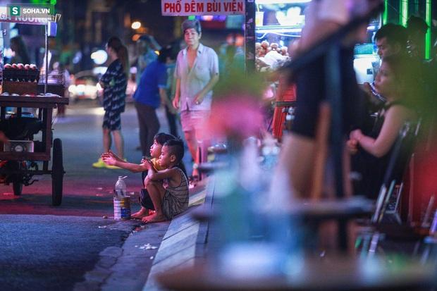 Những đứa trẻ không Tết thiếu nhi, trắng đêm phun lửa mưu sinh ở phố Tây Bùi Viện - Ảnh 10.