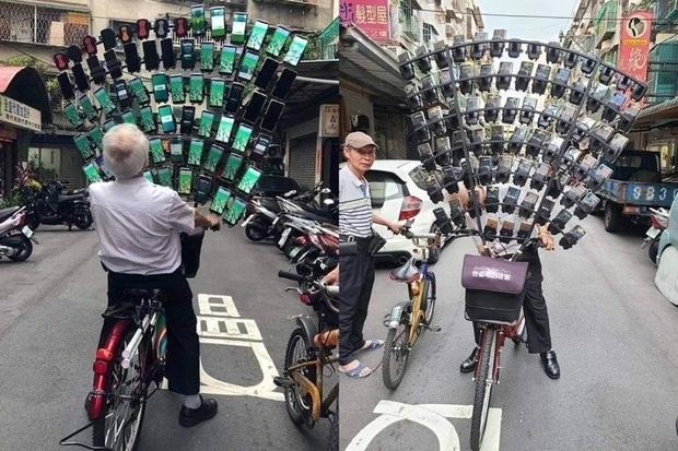 Cụ ông chạy chiếc xe đạp gắn đầy smartphone gây náo loạn cả khu phố, biết được lý do vì sao mới thật sự ngã ngửa - Ảnh 1.