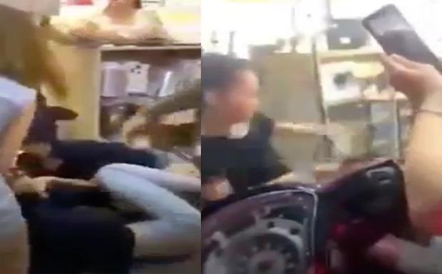 Xôn xao đoạn clip vợ chồng lao vào đánh nữ nhân viên tới tấp, đánh luôn người can ngăn - Ảnh 1.