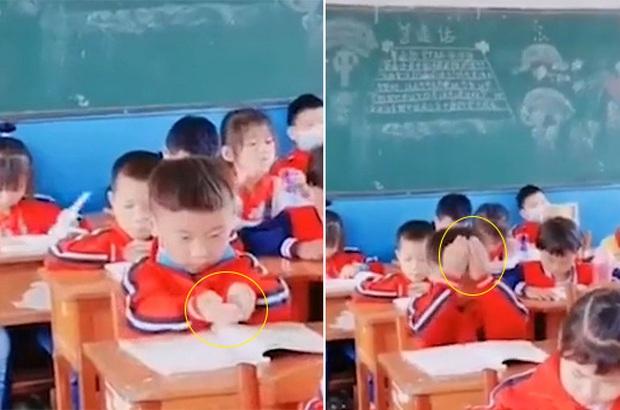 Dùng tay múc vội kiến thức vào đầu trước giờ kiểm tra, cậu bé khiến dân mạng cười bò vì đáng yêu hết mức - Ảnh 1.