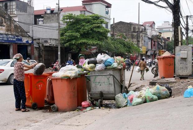 Người dân không phân loại rác sẽ phải trả nhiều tiền hơn - Ảnh 1.