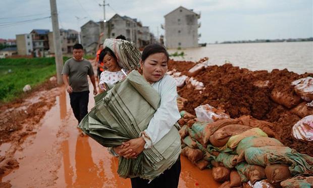 Trên 400 con sông tại Trung Quốc bị tràn bờ - Ảnh 1.