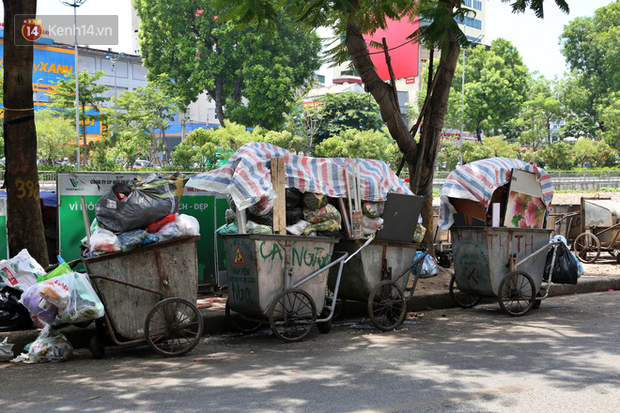 Hà Nội: Rác chất thành đống tràn ra khắp đường phố, nhiều người phải di tản vì phát ốm với mùi hôi thối - Ảnh 14.