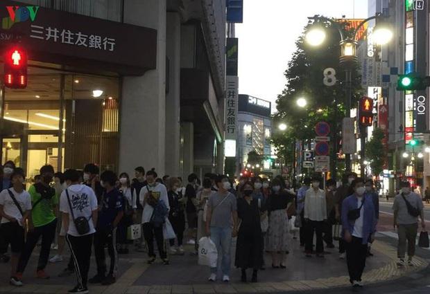 Ca nhiễm Covid-19 tại Nhật Bản chạm mốc thời đỉnh dịch - Ảnh 1.