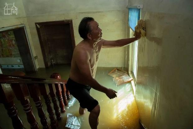 Người Trung Quốc giữa mênh mông sóng nước: Chống lũ, chống dịch bệnh, chống kẻ cắp - Ảnh 3.