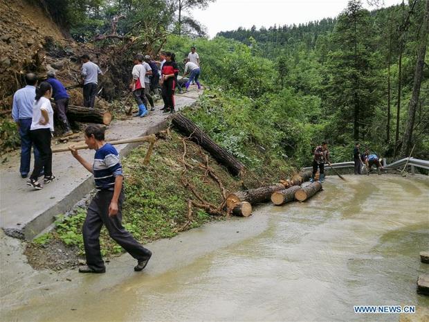 Lũ lụt ở Trung Quốc ngày càng đáng sợ: Hơn 12 triệu người dân phải điêu đứng, thiệt hại lên đến hơn 80 nghìn tỷ đồng - Ảnh 5.