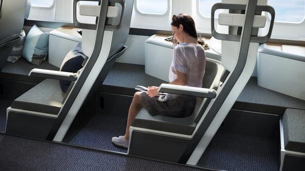 Cận cảnh khoang máy bay hạng phổ thông trong tương lai: Du khách có thể thoải mái nằm dài với thiết kế ghế ngồi hoàn toàn mới - Ảnh 4.