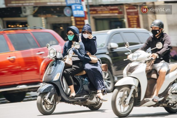 Cảnh báo đợt nắng nóng kéo dài trong nhiều ngày tới, chỉ số tia UV ở mức gây hại cao - Ảnh 1.
