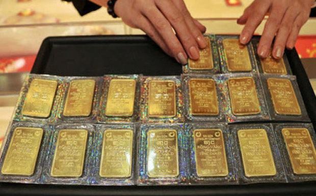 Giá vàng tiếp tục rớt mạnh, tuột mốc 60 triệu đồng/lượng - Ảnh 1.