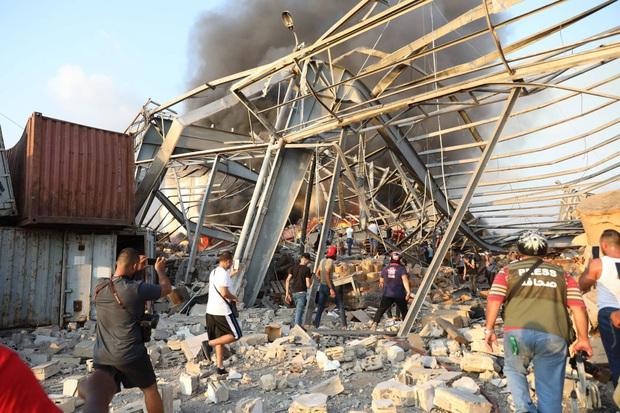 Chùm ảnh: Hiện trường như ngày tận thế sau vụ nổ kinh hoàng tại Lebanon khiến 4000 người thương vong - Ảnh 12.