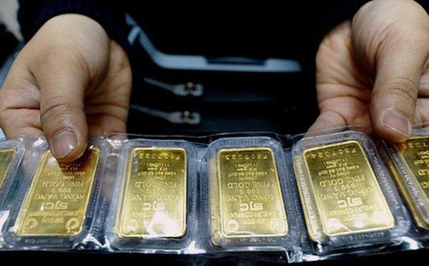 Giá vàng chính thức phá mốc 62 triệu đồng/lượng - Ảnh 1.