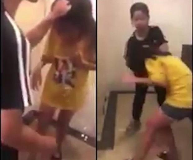 Nghệ An: Bé gái lớp 5 khóc lóc, van xin vẫn bị nhóm nữ sinh lớp 7 túm tóc, tát liên tiếp vào mặt - Ảnh 1.