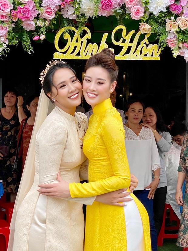 Khánh Vân làm dâu phụ trong đám cưới anh trai, dân tình dán mắt vào nhan sắc chị dâu từng thi Hoa hậu - Ảnh 2.
