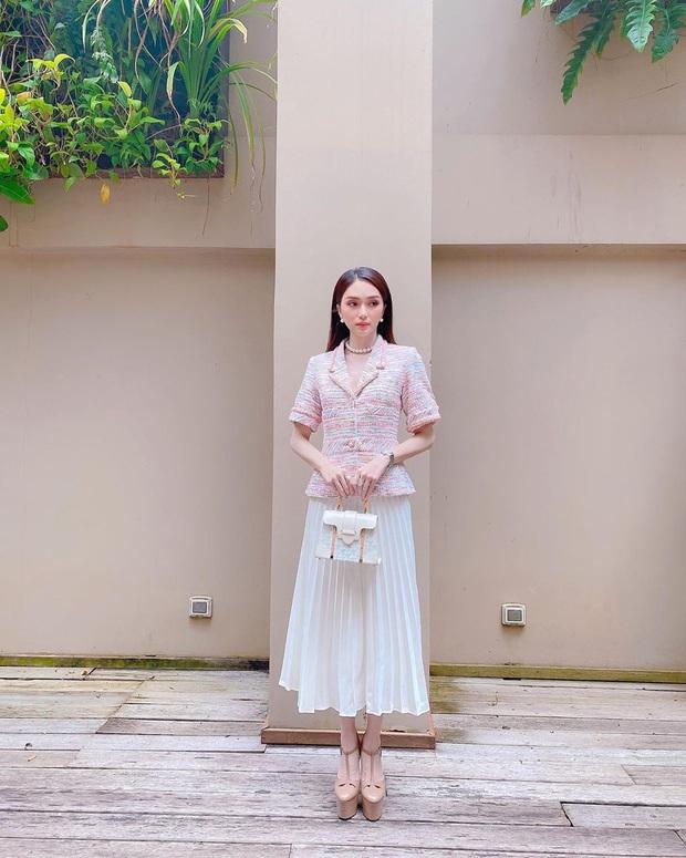 """Street style sao Việt: Ngọc Trinh vô tư diện bikini ra đường, Hương Giang """"tương"""" lại đôi giày cà kheo tai tiếng - Ảnh 2."""