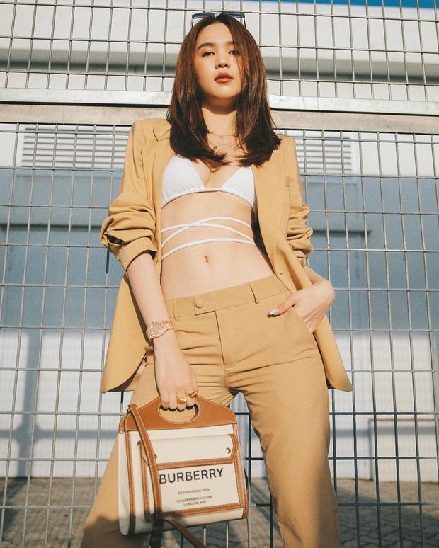 """Street style sao Việt: Ngọc Trinh vô tư diện bikini ra đường, Hương Giang """"tương"""" lại đôi giày cà kheo tai tiếng - Ảnh 1."""