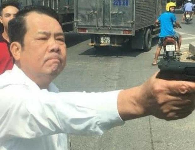 Giám đốc công ty bảo vệ dọa bắn vỡ sọ tài xế bị khởi tố - Ảnh 1.