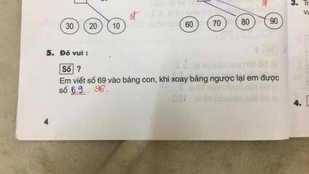 Bài Toán: Viết số 69 ra bảng, xoay ngược lại được số bao nhiêu?, học sinh nói 69, cô giáo bảo 96 - Ảnh 1.