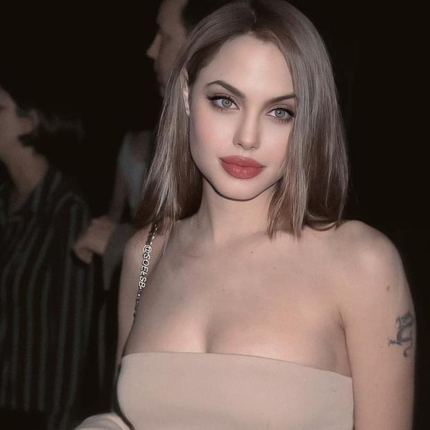 Dân tình đang náo loạn vì bộ ảnh Angelina Jolie ở thời kỳ đẹp nhất: Mặt như tạc, body ngộp thở, bảo sao Brad Pitt mê mệt - Ảnh 4.