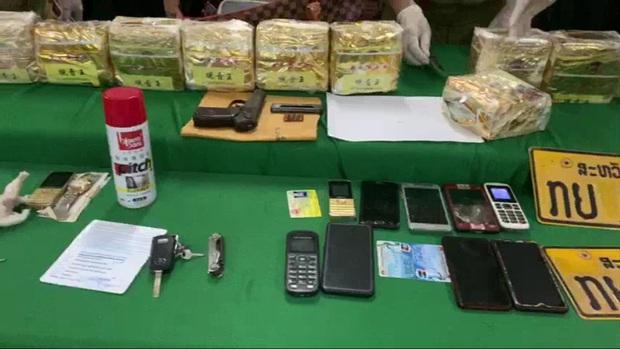 Biên phòng giăng lưới bắt 8 người Lào có súng K59, cõng 10kg ma túy qua biên giới - Ảnh 2.