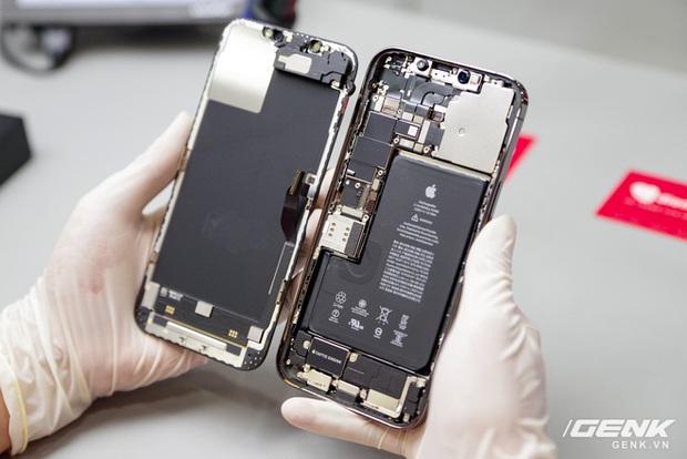 Mổ bụng iPhone 12 Pro Max tại Việt Nam: pin chữ L dung lượng 3.687mAh, camera sau vừa to vừa dài - Ảnh 1.