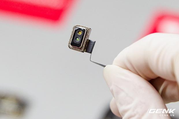 Mổ bụng iPhone 12 Pro Max tại Việt Nam: pin chữ L dung lượng 3.687mAh, camera sau vừa to vừa dài - Ảnh 4.