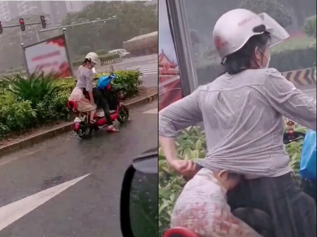 Chở con đi học về thì trời mưa tầm tã, người mẹ làm hành động lạ khiến ai nhìn cũng rưng rưng nước mắt - Ảnh 1.