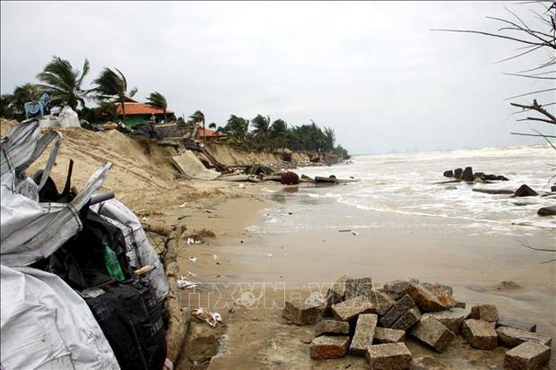Sạt lở nghiêm trọng gần 4km bờ biển Hội An - Ảnh 1.