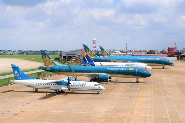 Vietnam Airlines Group khuyến cáo hành khách dịp cao điểm Tết: Cảnh giác với những website bán vé không chính thức, được thiết kế gần giống website chính thức của hãng - Ảnh 1.