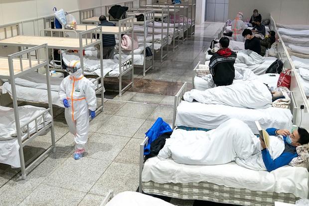 Loạt ảnh Trung Quốc năm 2020: Khủng hoảng và đau thương vì COVID-19, các di tích hàng trăm năm tuổi lần lượt bị nuốt chửng khi mẹ thiên nhiên nổi giận - Ảnh 6.