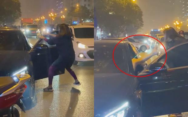 Vụ người phụ nữ chặn đầu xe Mercedes đánh ghen trên phố Hà Nội: Khi cảnh sát đến đã giải tán - Ảnh 1.