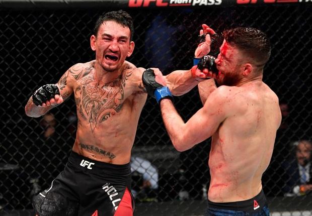 Bị giã lên người số cú đòn nhiều kỷ lục, gương mặt võ sĩ trở nên sưng vù, ghê rợn nhất là chiếc mũi bị biến dạng hoàn toàn - Ảnh 4.