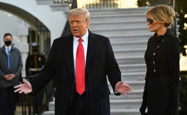 Những khoảnh khắc cuối cùng của ông Donald Trump trên cương vị Tổng thống Mỹ: Tươi cười, vẫy tay chào tạm biệt trước sự chứng kiến của gia đình - Ảnh 4.