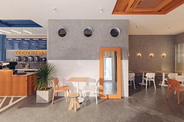 Quán cà phê container rực rỡ sắc cam ở Cần Thơ nổi bật trên báo ngoại - Ảnh 6.