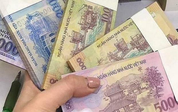 ph.ạt nặng việc đổi tiền lẻ kiếm lời dịp Tết Nguyên đán Tân Sửu 2021 - Ảnh 2.