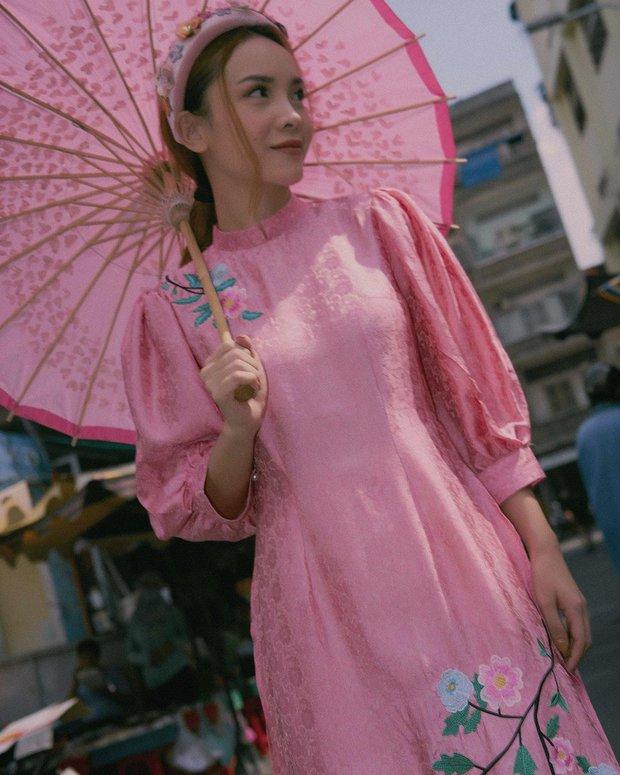 2 tuần nữa mới Tết nhưng mỹ nhân Việt đã thi nhau thả dáng với áo dài: Người đơn giản chất chơi, người lồng lộn hết sức - Ảnh 4.