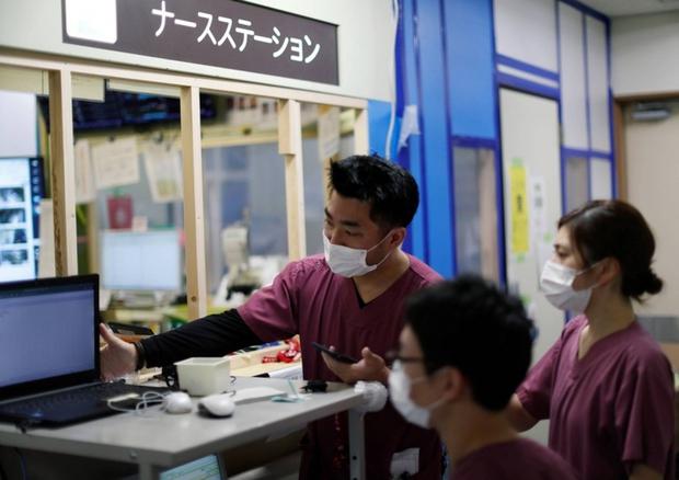 Nhật Bản có thể vẫn duy trì tình trạng khẩn cấp do Covid-19 - Ảnh 1.