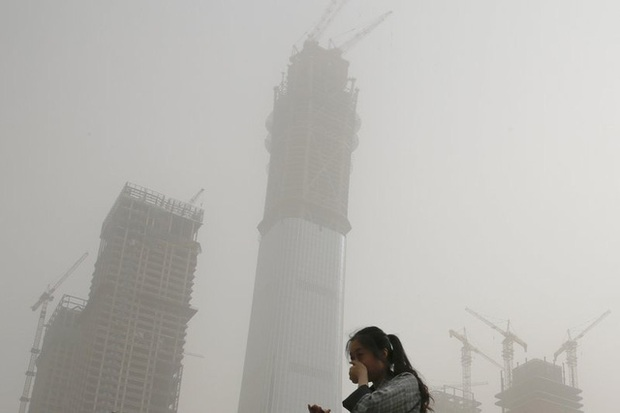 Bắc Kinh ô nhiễm nặng dịp Tết Nguyên đán, chỉ số bụi mịn vượt ngưỡng hơn 10 lần - Ảnh 1.